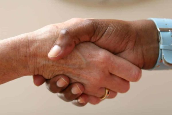 two people shaking hands in agreement